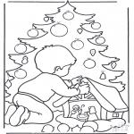 Natal - Rapaz com árvore de Natal